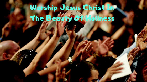 People lifting their hands and worshiping Jesus Christ